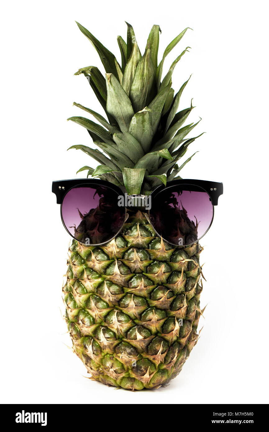juicy pineapple in sunglasses, isolated on white background, concept of summer vacation - Stock Image