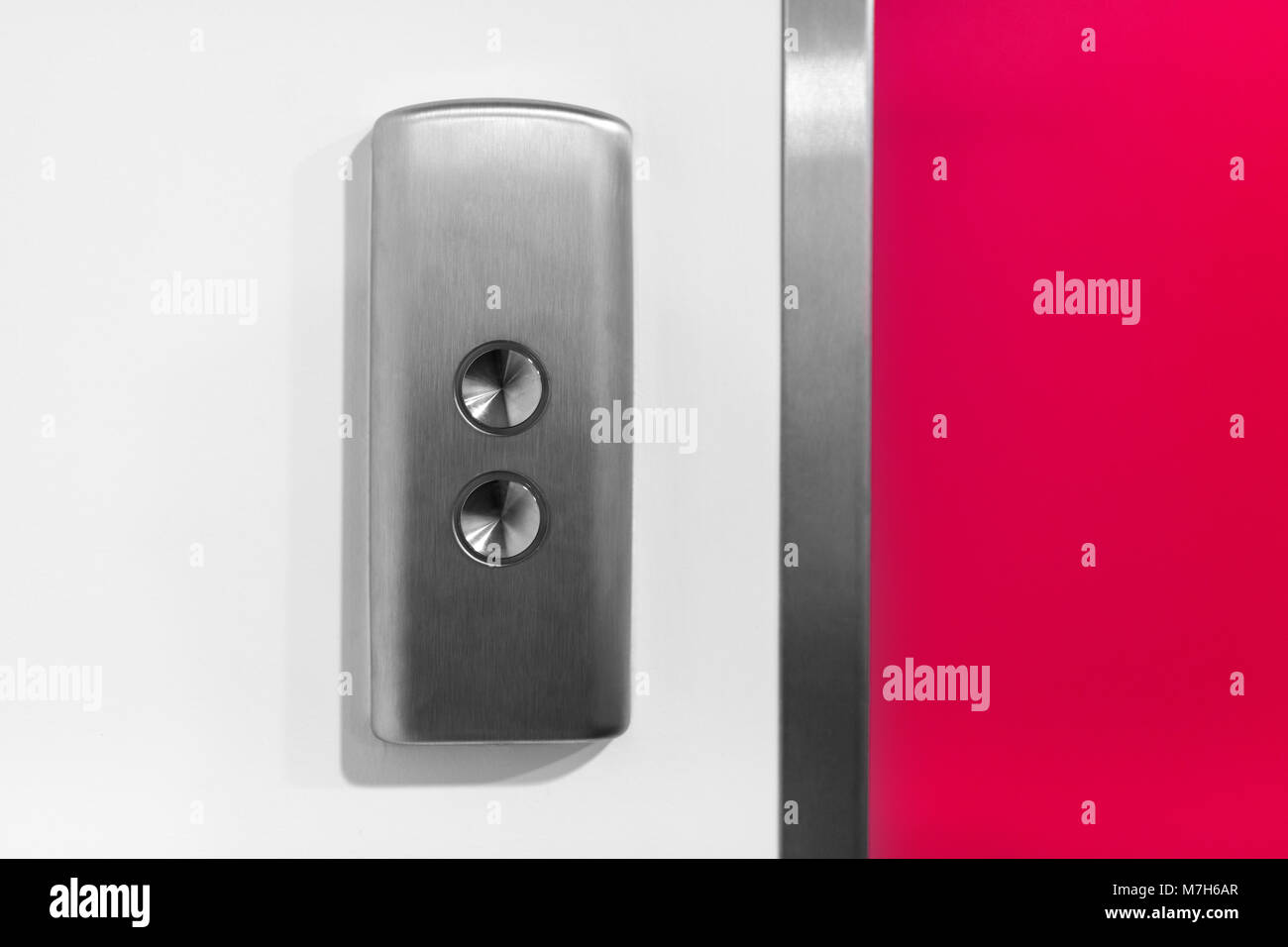 Metal elevator Button on the white wall - Stock Image
