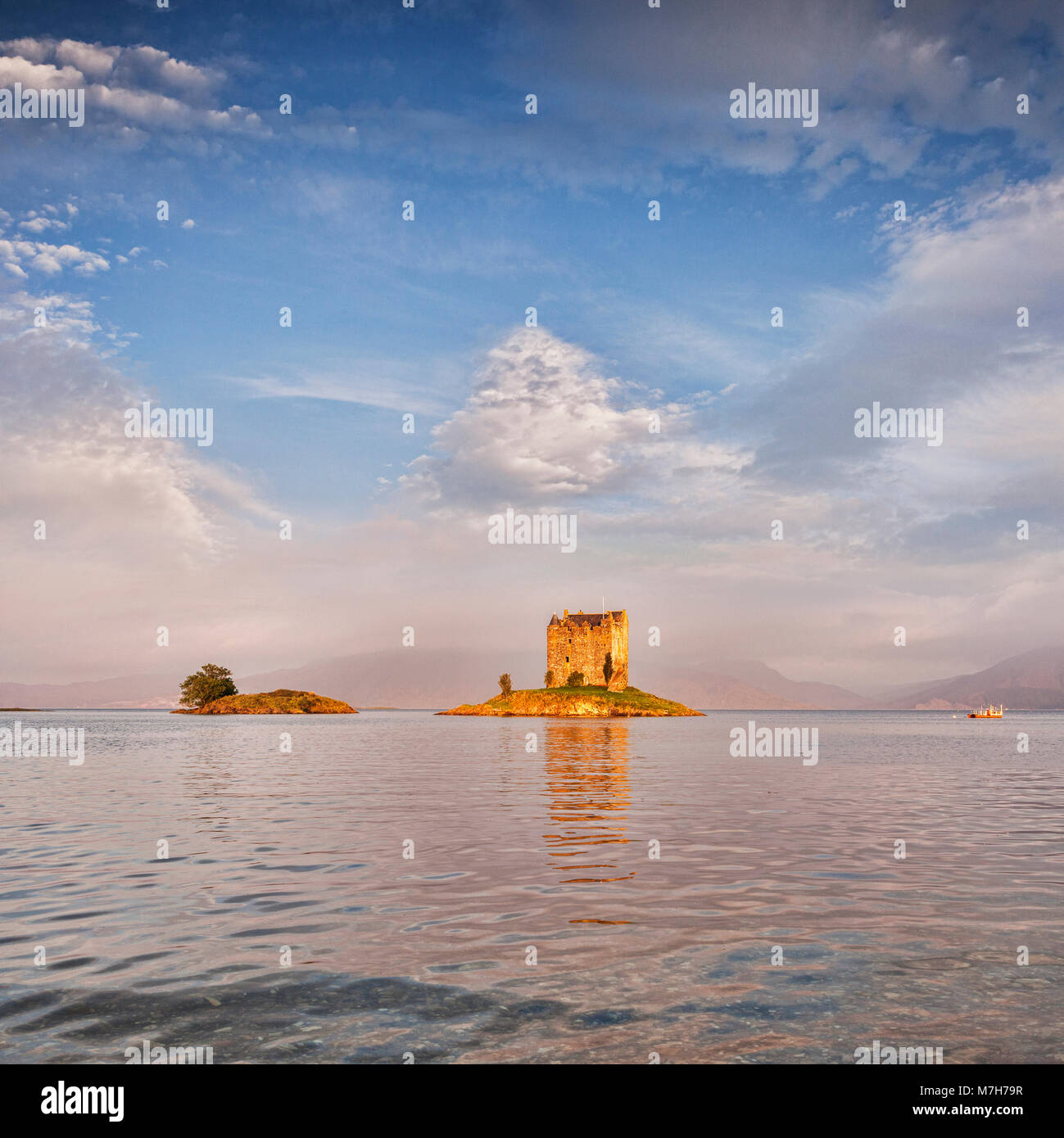 Castle Stalker, an example of a Scottish tower house set on a tidal islet on Loch Laich, an inlet off Loch Linnhe. - Stock Image