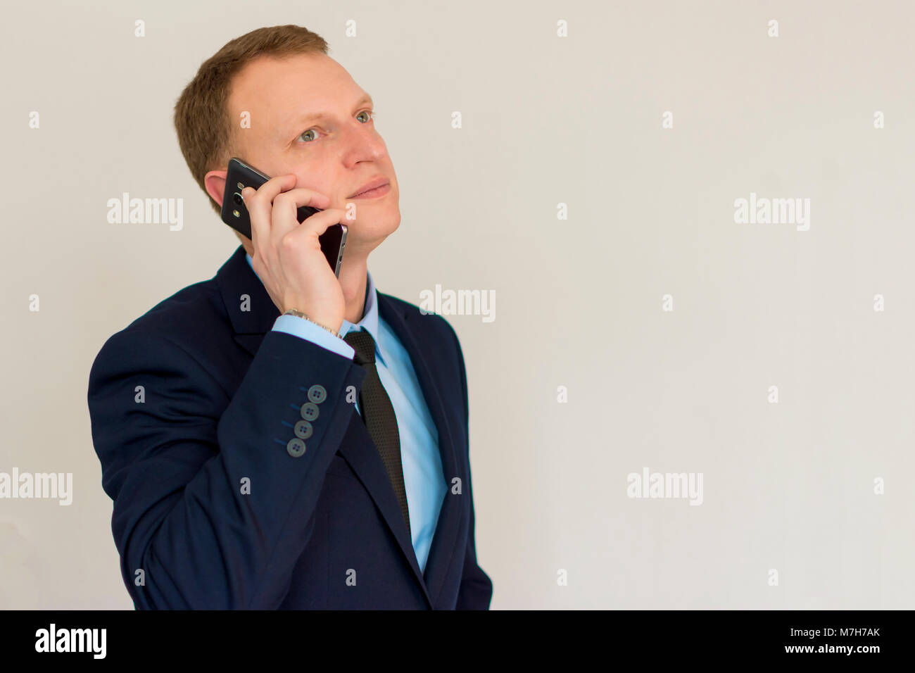 Business man speaking on mobile phone - Stock Image