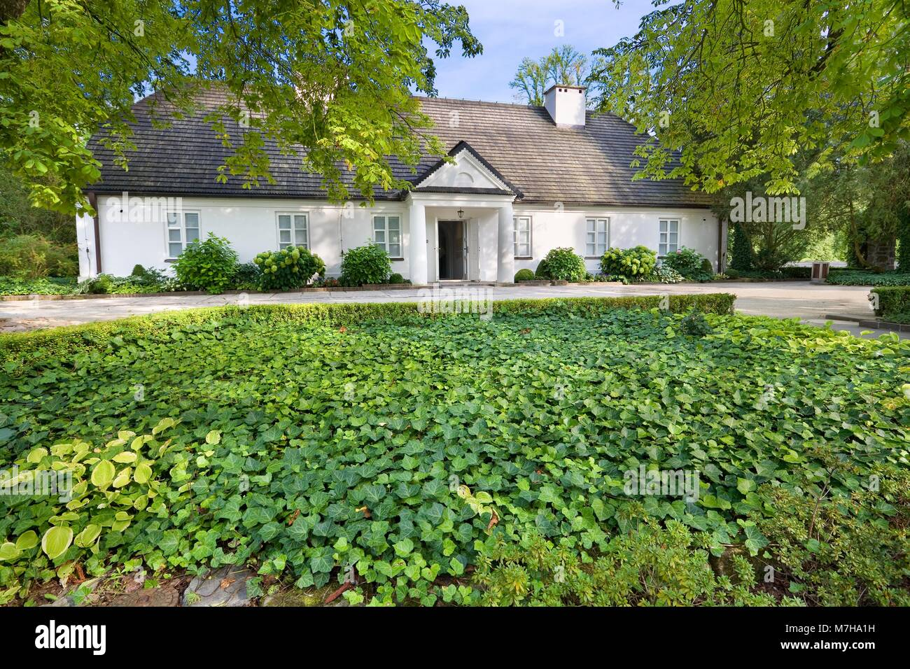 Little manor-house - birthplace of famous Polish composer - Frederick Chopin in Zelazowa Wola, Poland - Stock Image