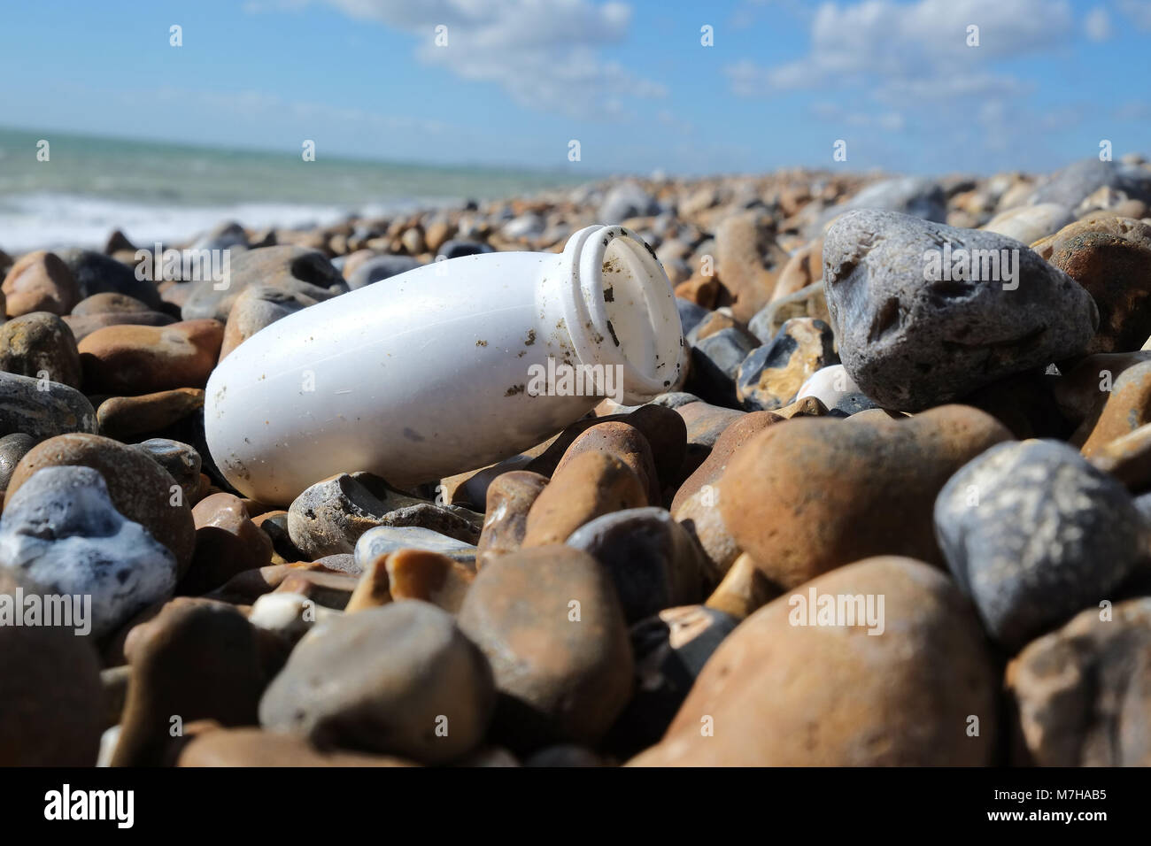 Plastic bottle on the beach at Shoreham by Sea in Sussex Beach rubbish washed ashore - Stock Image