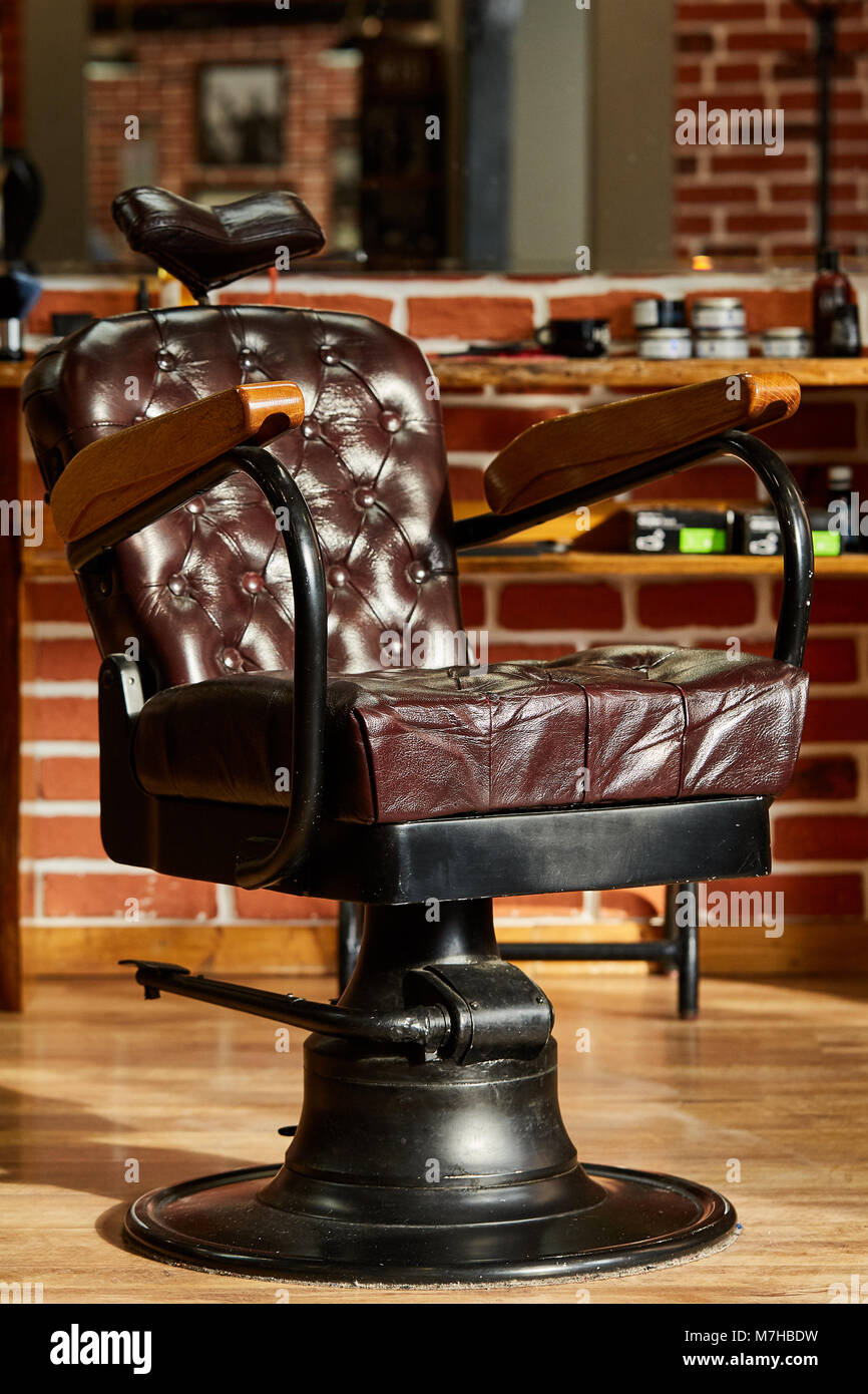 barber shop hairdresser chairs made from brown leather retro stock