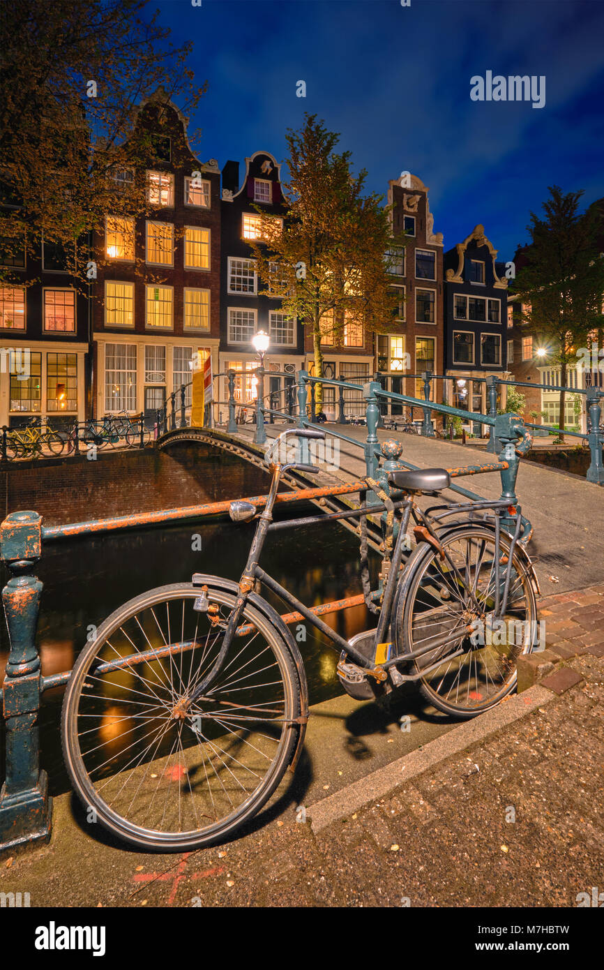 Amterdam canal, bridge and medieval houses in the evening - Stock Image