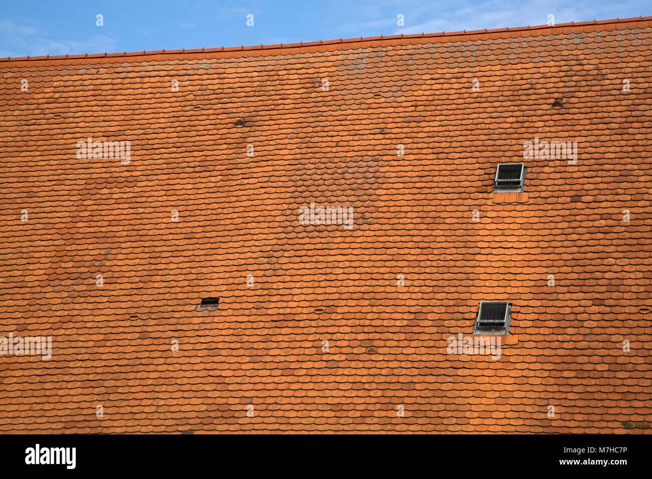 Weathered ceramic roof tiles stock photos weathered ceramic roof pitched roof with terracotta ceramic tiles stock image dailygadgetfo Image collections