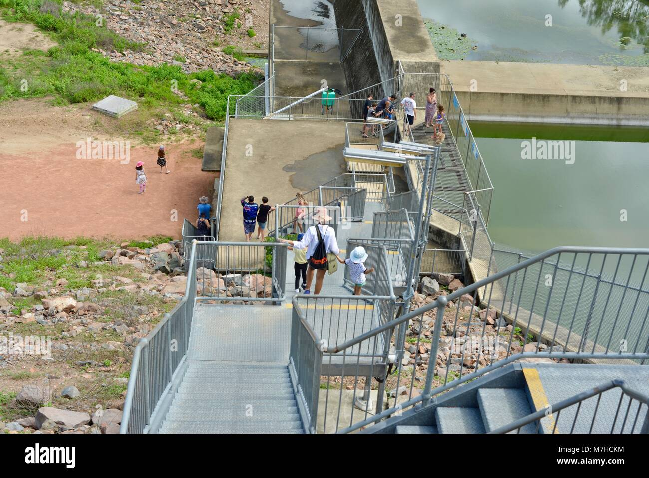 Children and adults walking down galvanised steel stairs, Ross River Dam, Ross Dam Access, Kelso QLD, Australia - Stock Image