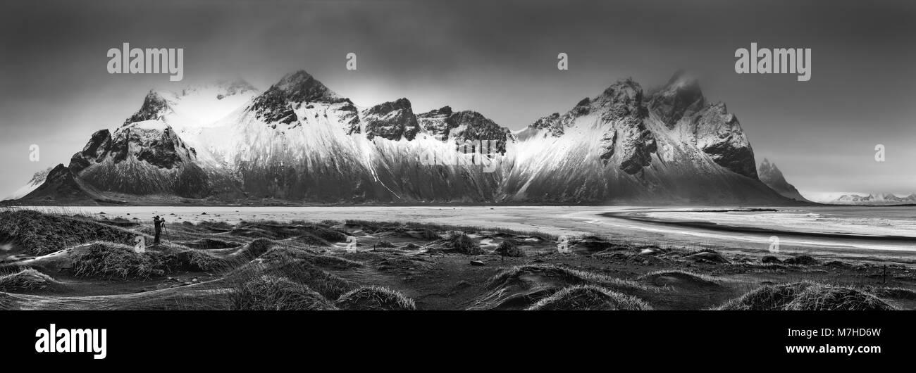 Vestrahorn mountain range and Stokksnes beach panorama, near Hofn, Iceland. An unidentifiable photographer captures - Stock Image