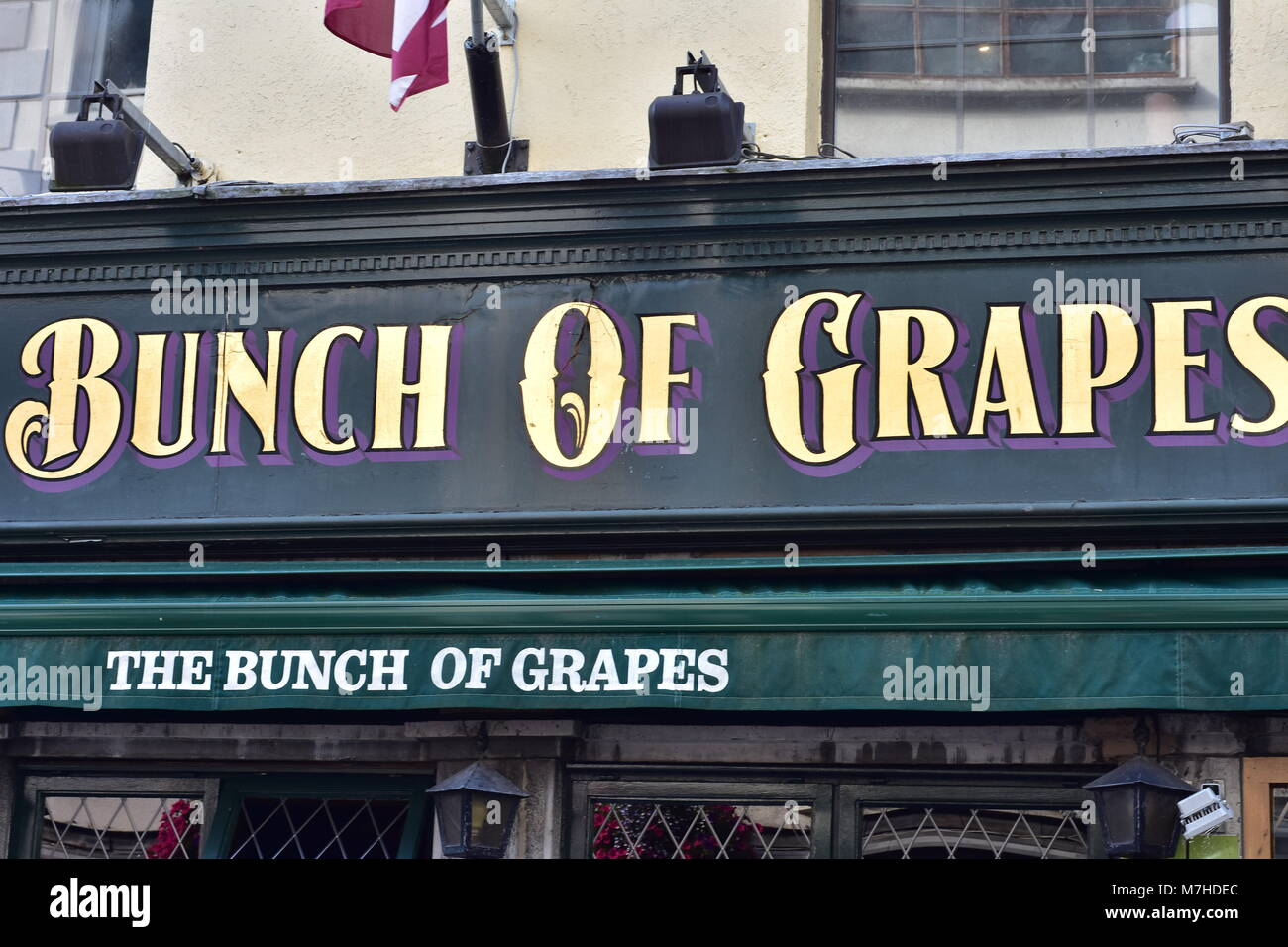 Sign of family run pub The Bunch of Grapes on High Street in center of Galway in Ireland. - Stock Image