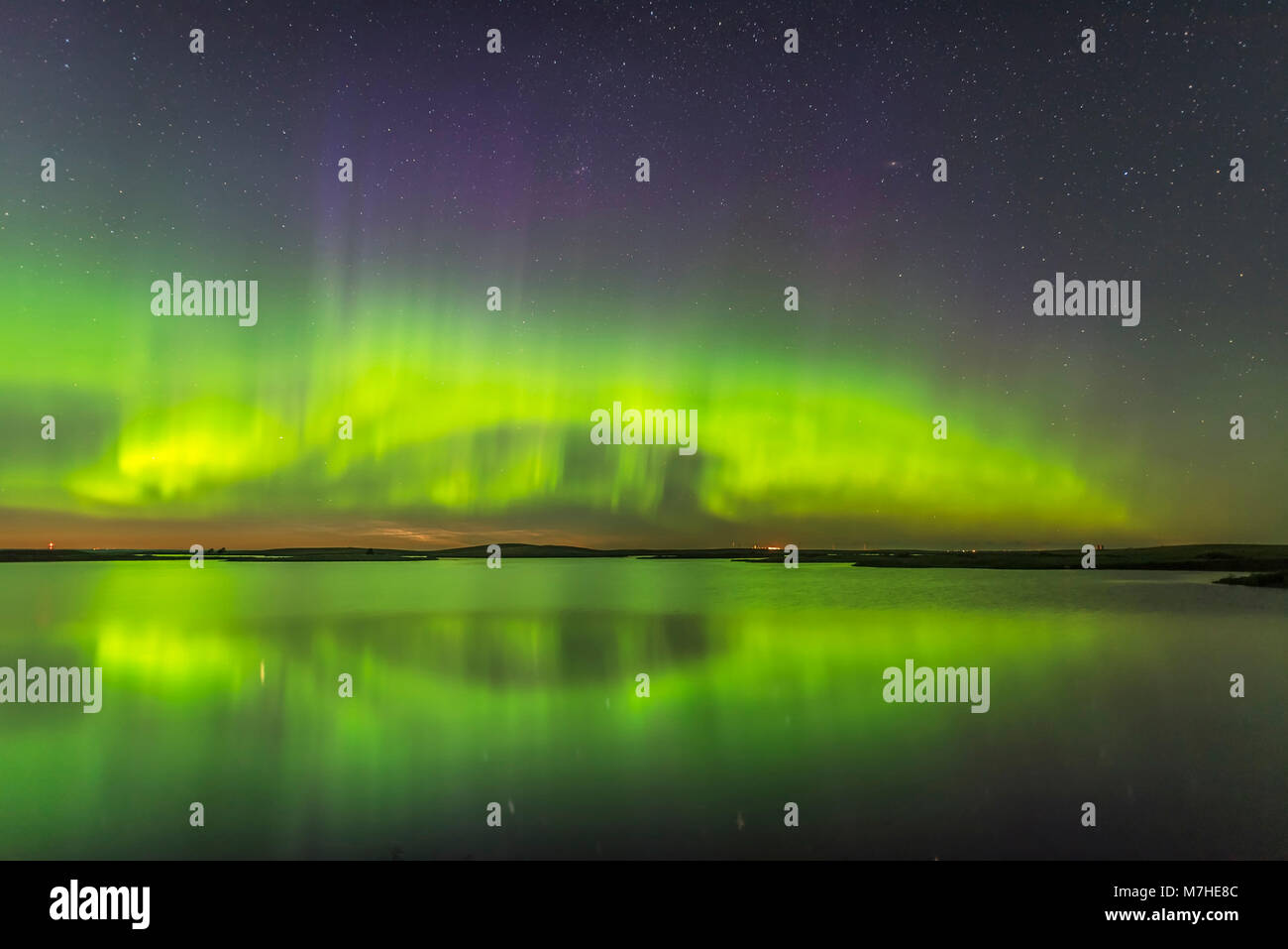 The northern lights and a faint display of noctilucent clouds above Crawling Lake, Canada. Stock Photo