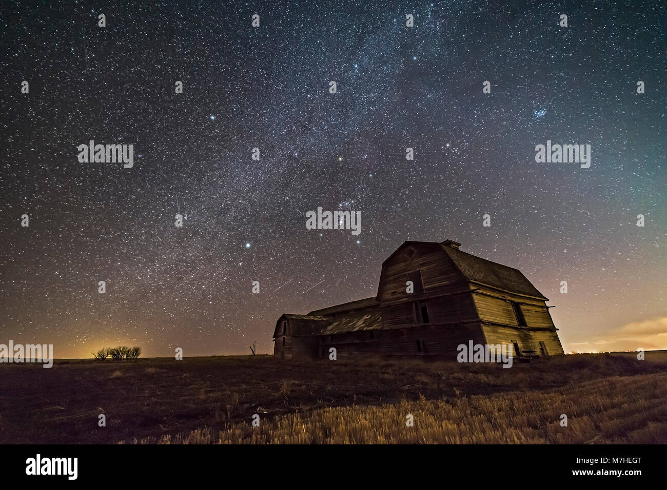 Orion and the winter Milky Way over an old barn in Alberta, Canada. Stock Photo