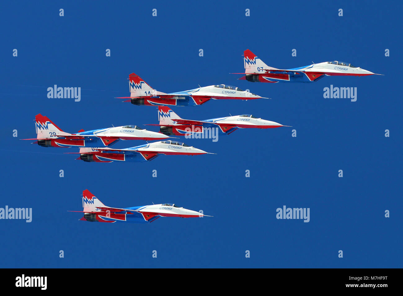 MiG-29UB jet fighters of the Russian Swifts aerobatic team. Stock Photo
