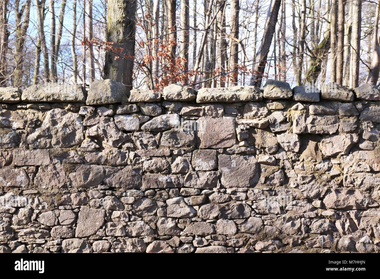 Stone wall barrier, obstacle, difficulty - Stock Image