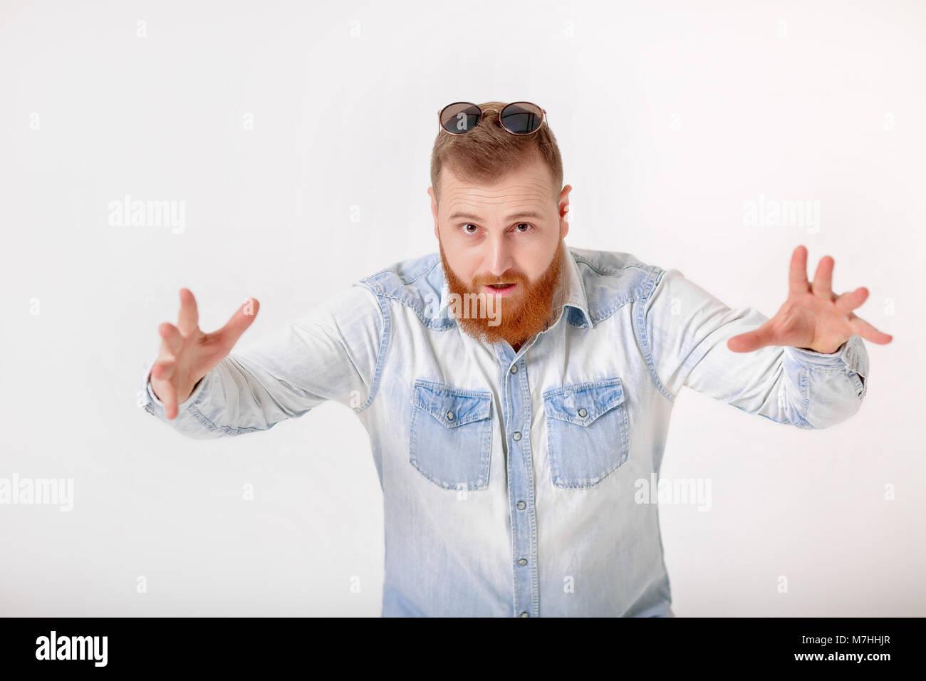 beard man in sunglasses and denim shirt - Stock Image