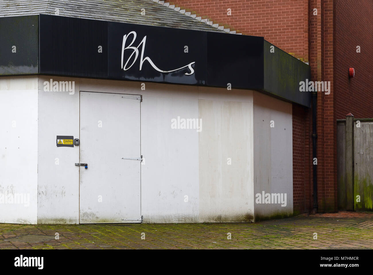 Boarded up BHS shop entrance in Chester city centre UK - Stock Image