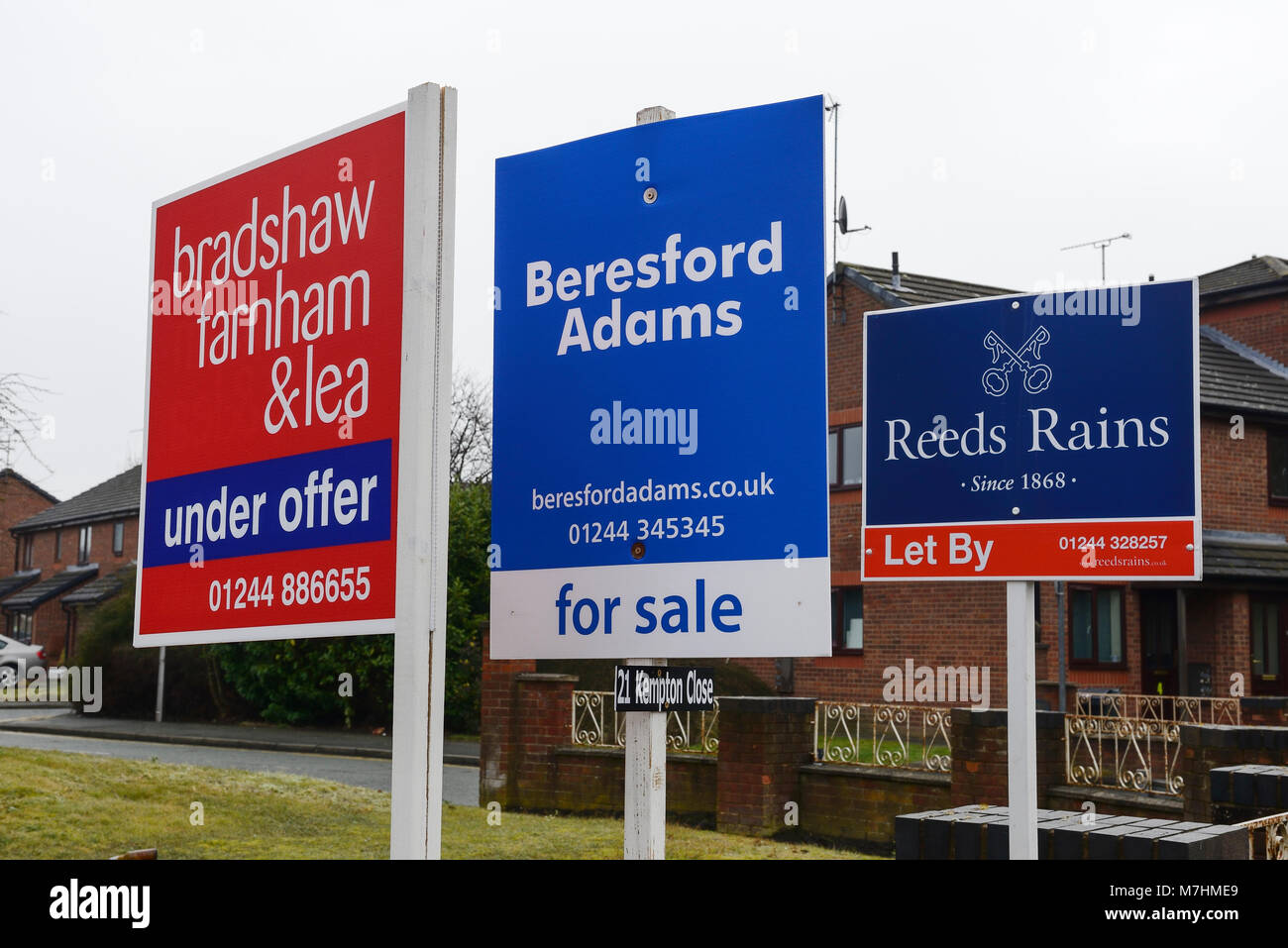 Multiple estate agent for sale boards - Stock Image