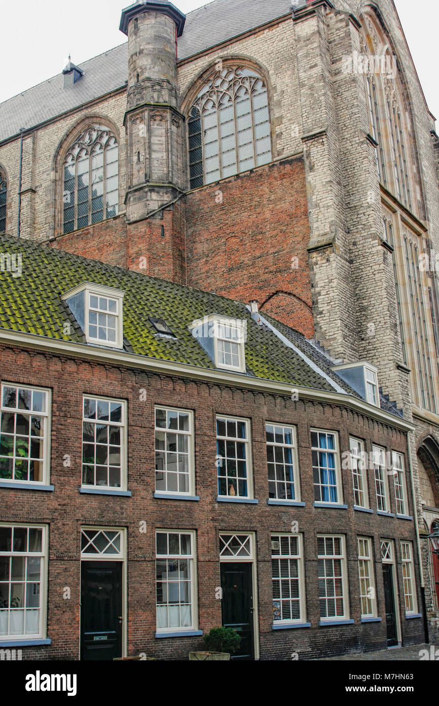 Medieval houses close to a medieval church in Dutch town of Leiden Stock Photo