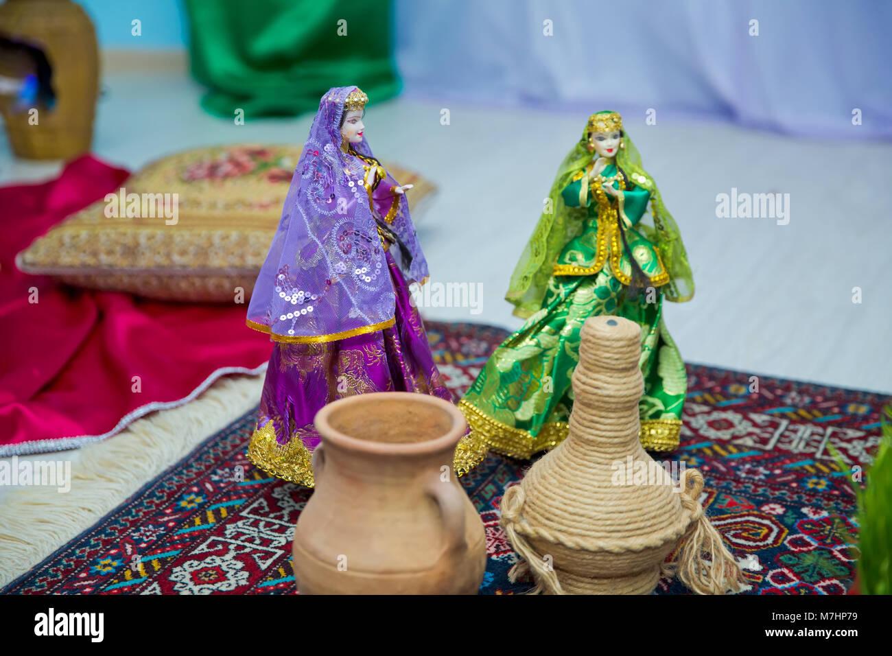 Azerbaijan national womens puppet wear. Ancient Azerbaijan military sword . Azerbaijani national costume - Stock Image