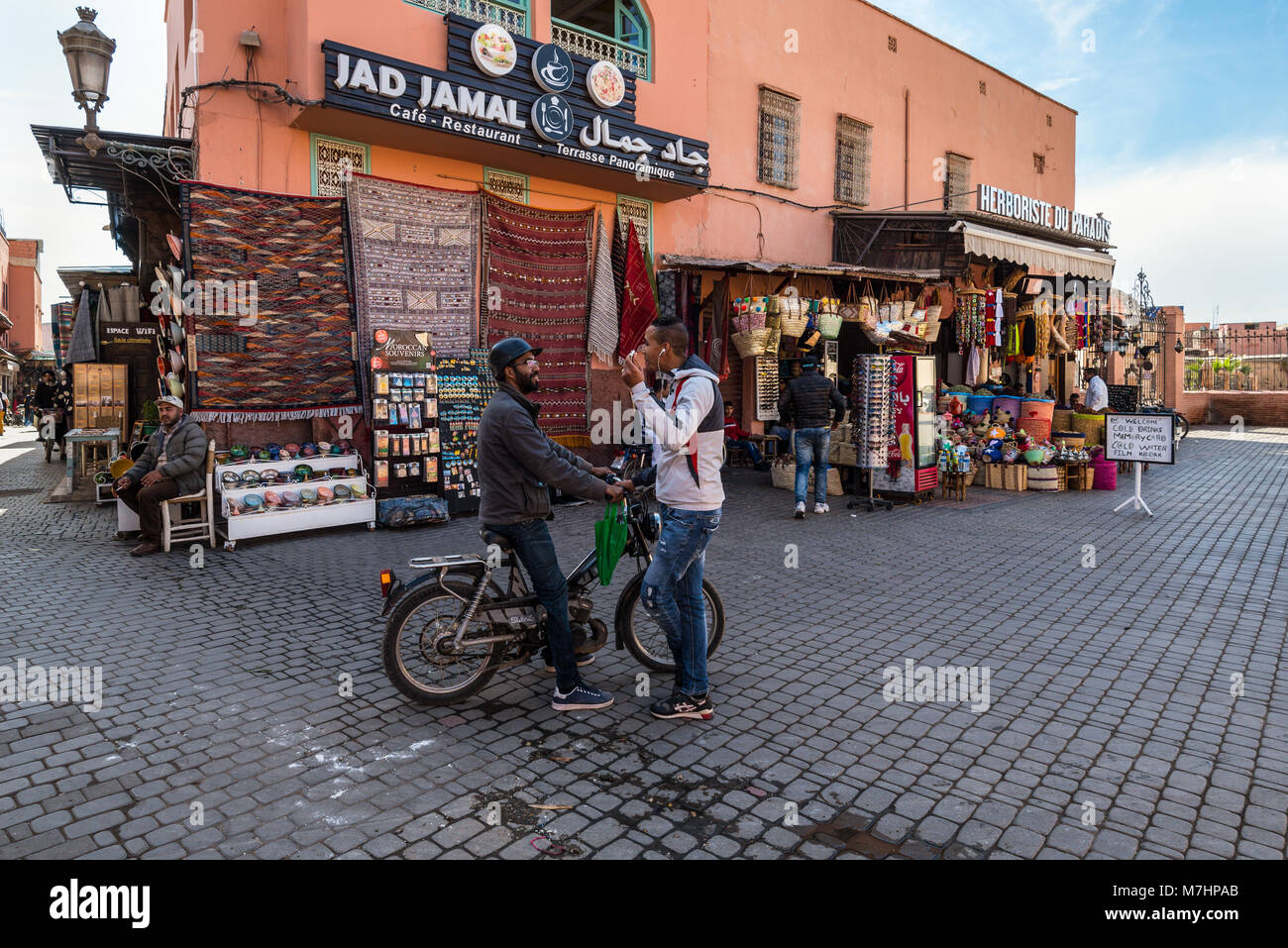 Marrakesh, Morocco - December 8, 2016: Unidentified people at a street in the medina of Marrakesh, Morocco. With Stock Photo