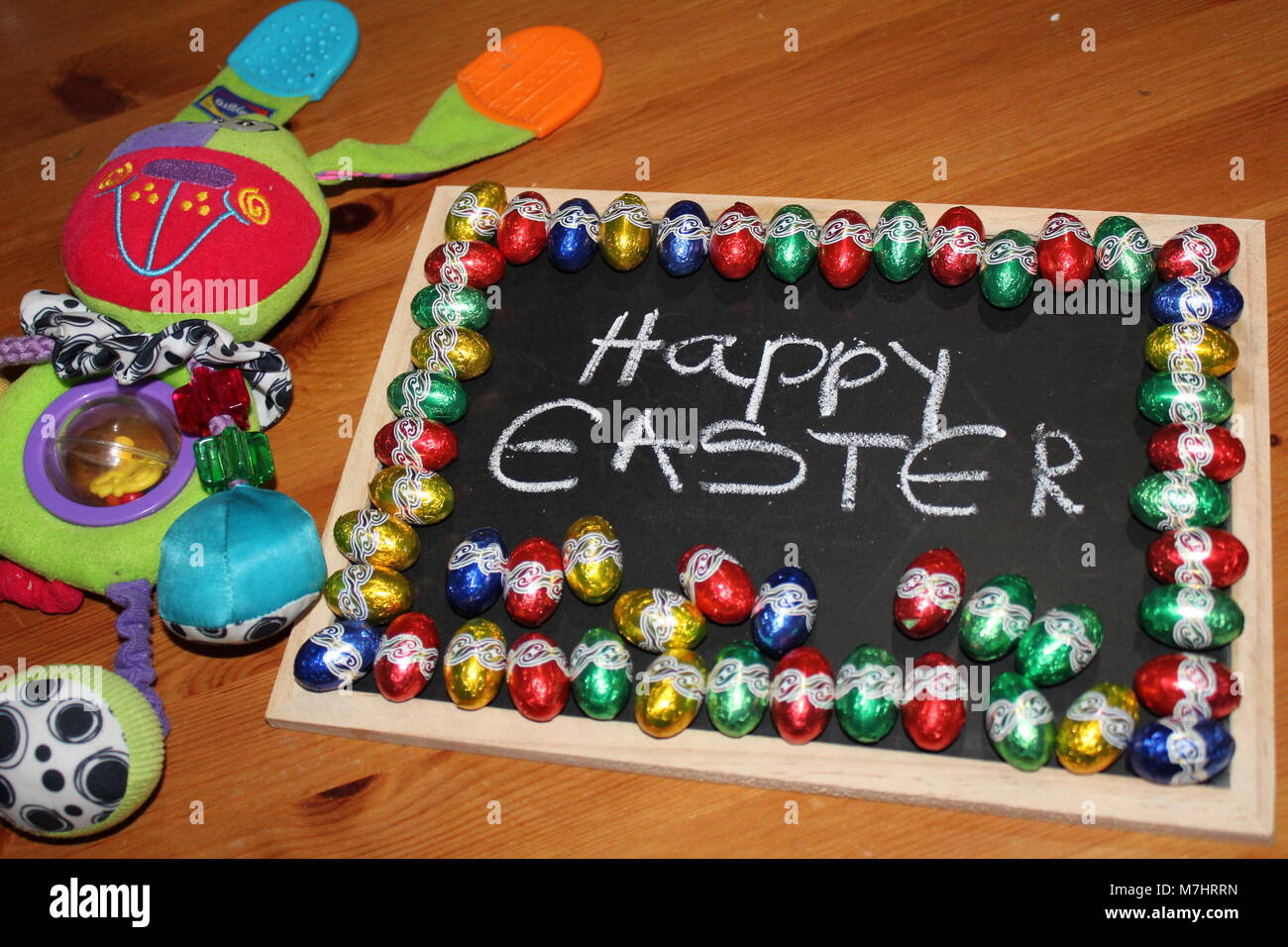 Happy easter bunny baby teething toy - Stock Image