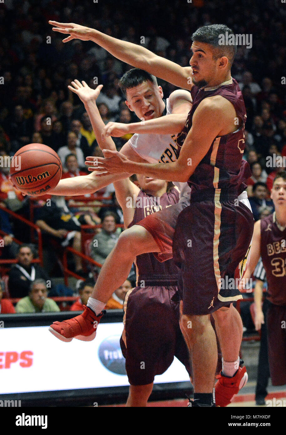 Albuquerque, NM, USA. 10th Mar, 2018. Belen's #34 Ryan Garcia guards Espanola's #3 Christian Fernandez and forces him to pass off the ball. Saturday, March. 10, 2018. Credit: Jim Thompson/Albuquerque Journal/ZUMA Wire/Alamy Live News Stock Photo