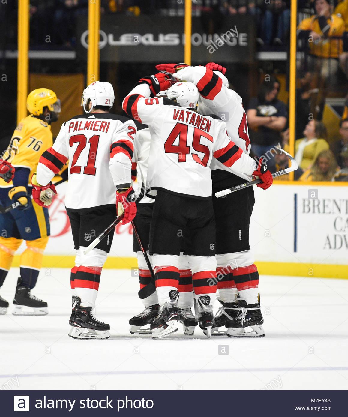 Bridgestone Arena. 10th Mar, 2018. USA New Jersey Devils defenseman Sami Vatanen (45) celebrates with his teammates - Stock Image