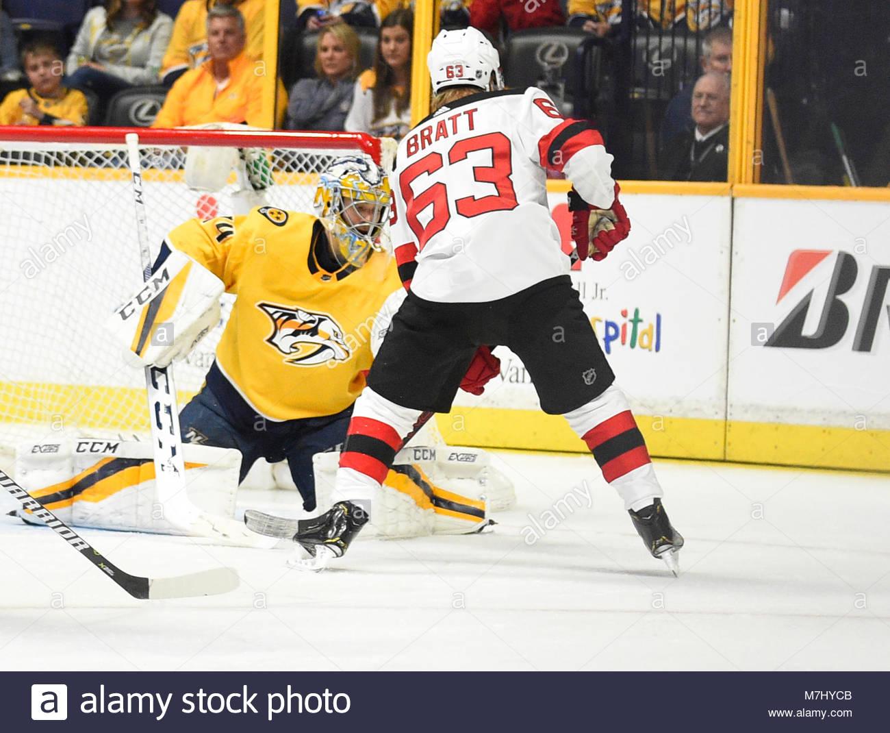 Bridgestone Arena. 10th Mar, 2018. USA Nashville Predators goaltender Juuse Saros (74) blocks the deflection of - Stock Image
