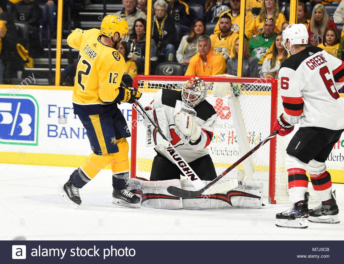Bridgestone Arena. 10th Mar, 2018. USA Nashville Predators center Mike Fisher (12) has his shot blocked by New Jersey - Stock Image