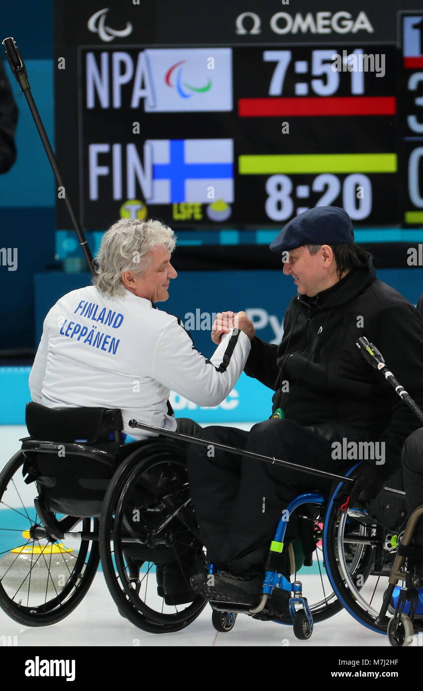 Finland s Vesa Leppanen (L) and neutral Paralympic athlete (NPA) from  Russia Marat Romanov shake hands in their mixed Round Robin Session 4  wheelchair ... 8b7d7cb5fa