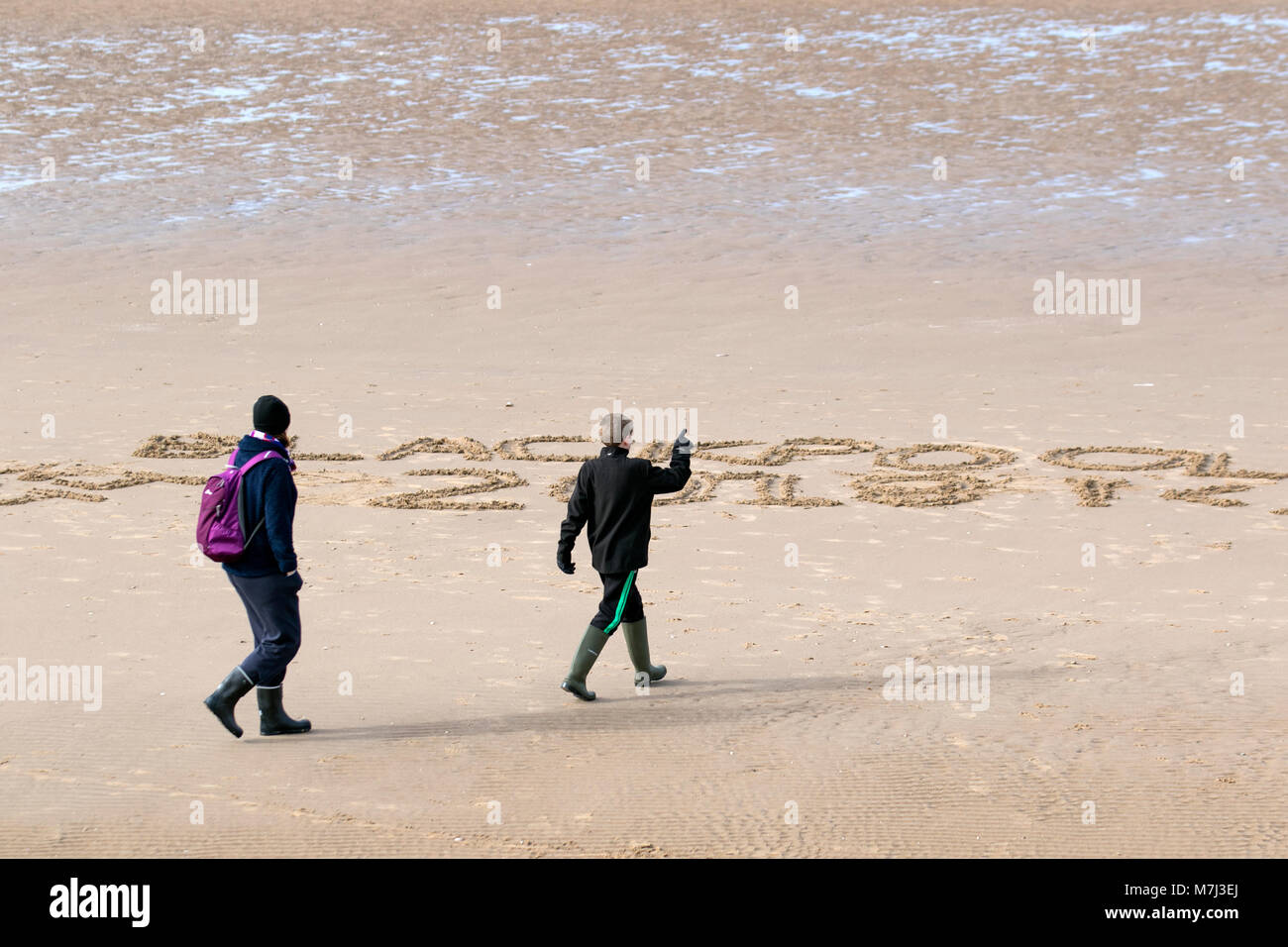 Blackpool, Lancashire. UK Weather. 11th March, 2018. Warm spring day at the coast as holidaymakers and tourists - Stock Image