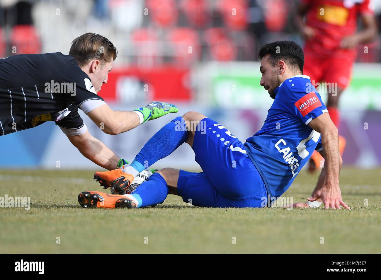 Burak Camoglu (KSC, r.) im Duell with goalwart Philipp Klewin (RW, l.).  GES/ Fussball/ 3. Liga: RW Erfurt - Karlsruher - Stock Image