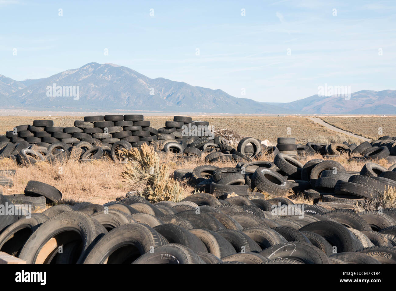 Tires waiting to become house walls in the New Mexico high desert. - Stock Image