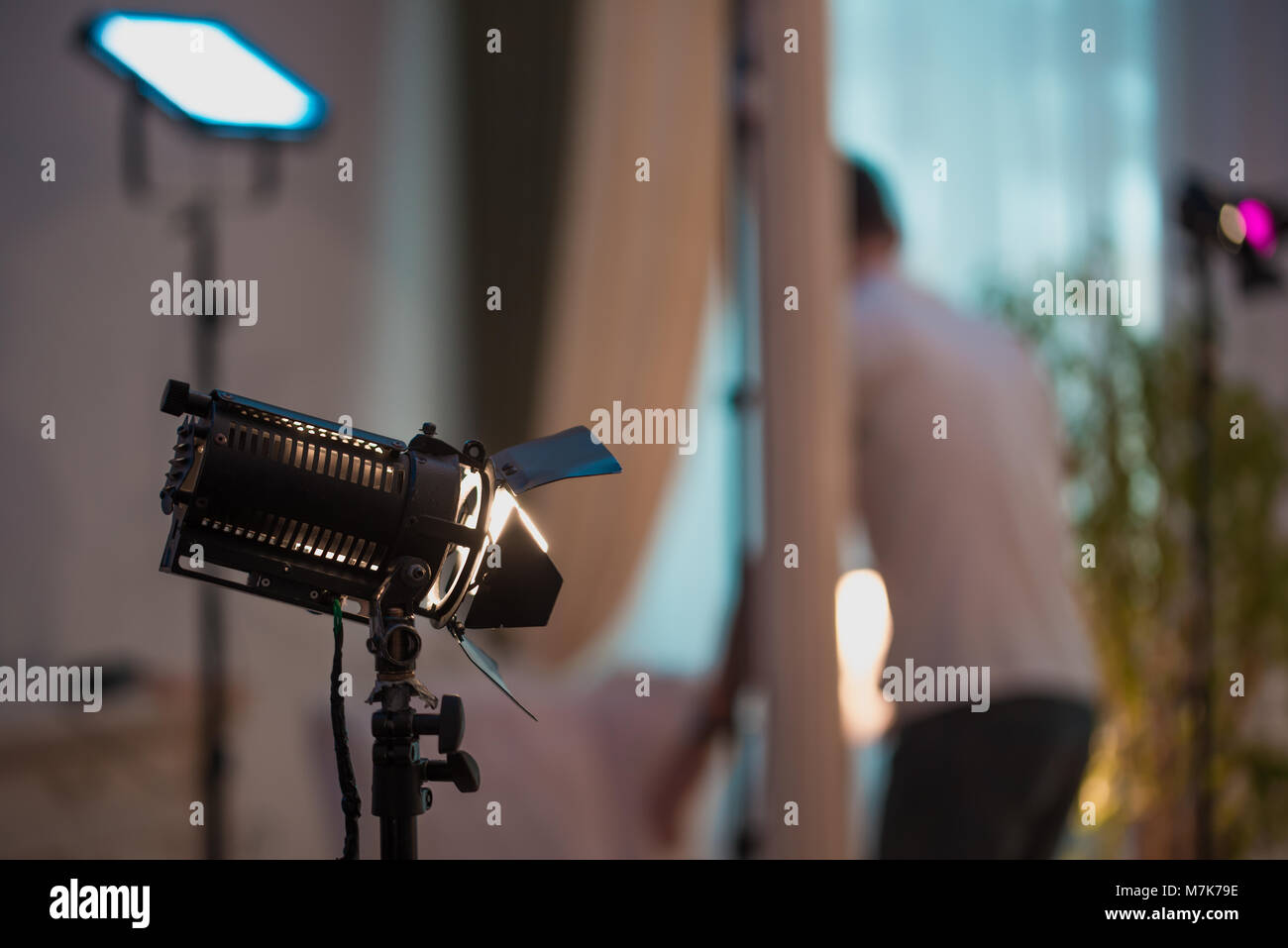 Professional cinema lamps with continuous light standing in the dark room. - Stock Image