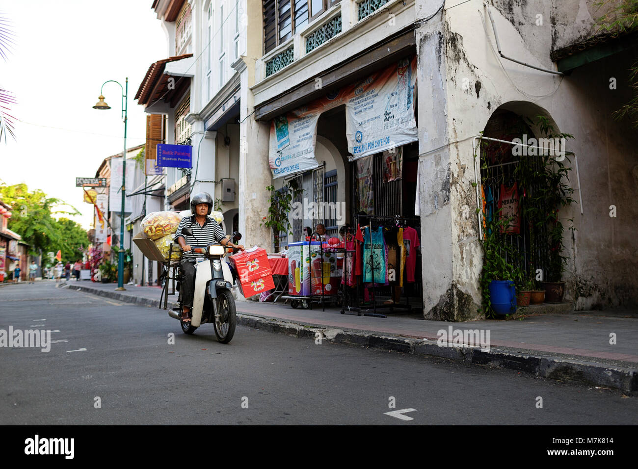 Motorbike and typical street scene at traditional Chinese shop houses in the UNESCO World Heritage zone of Georgetown Stock Photo