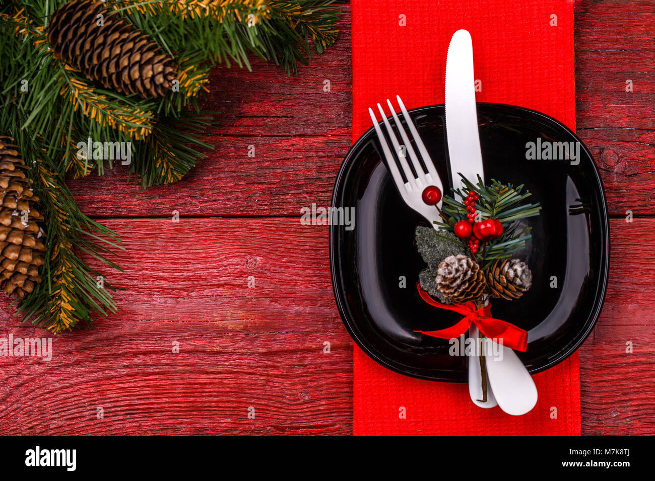 Christmas Table Place Setting With Red Napkin Black Plate White Stock Photo Alamy