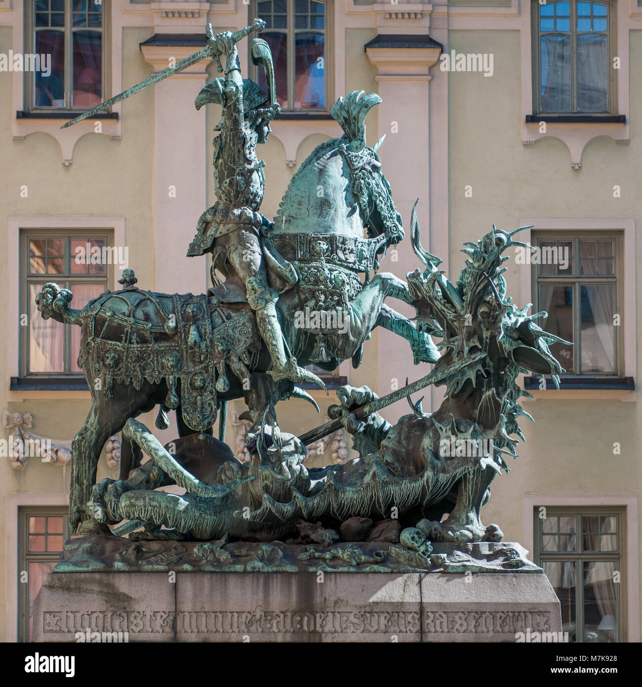 Statue of Saint George and the dragon in medieval Old Town of Stockholm. The historic Old Town is a major tourist - Stock Image