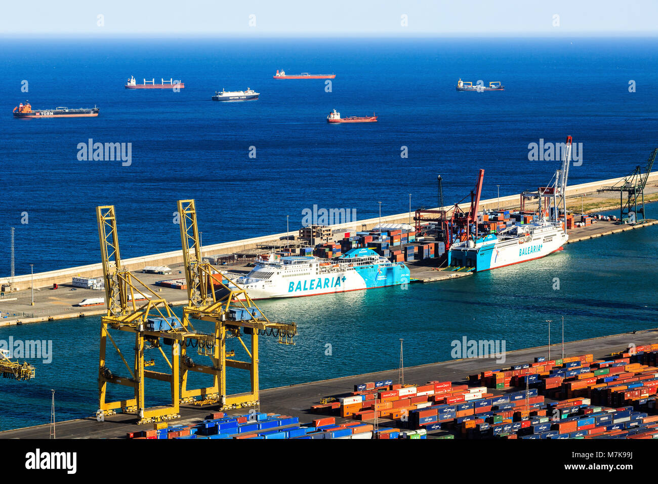 Panoramic view of the cargo port in Barcelona, sunset time, aerial view - Stock Image