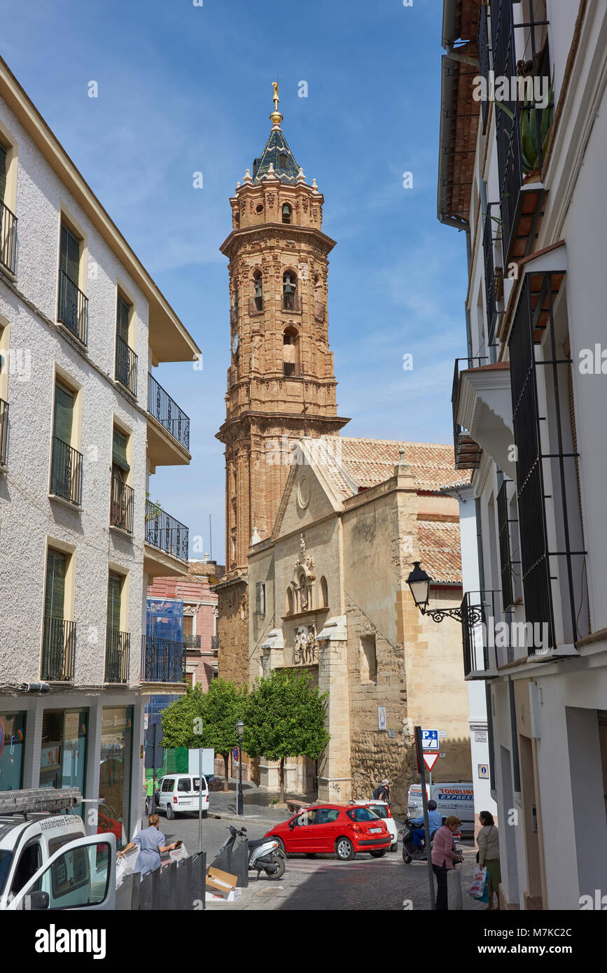 The Real Collegiate de San Sebastian, with its Baroque Bell tower looks down over the busy surrounding Houses and - Stock Image