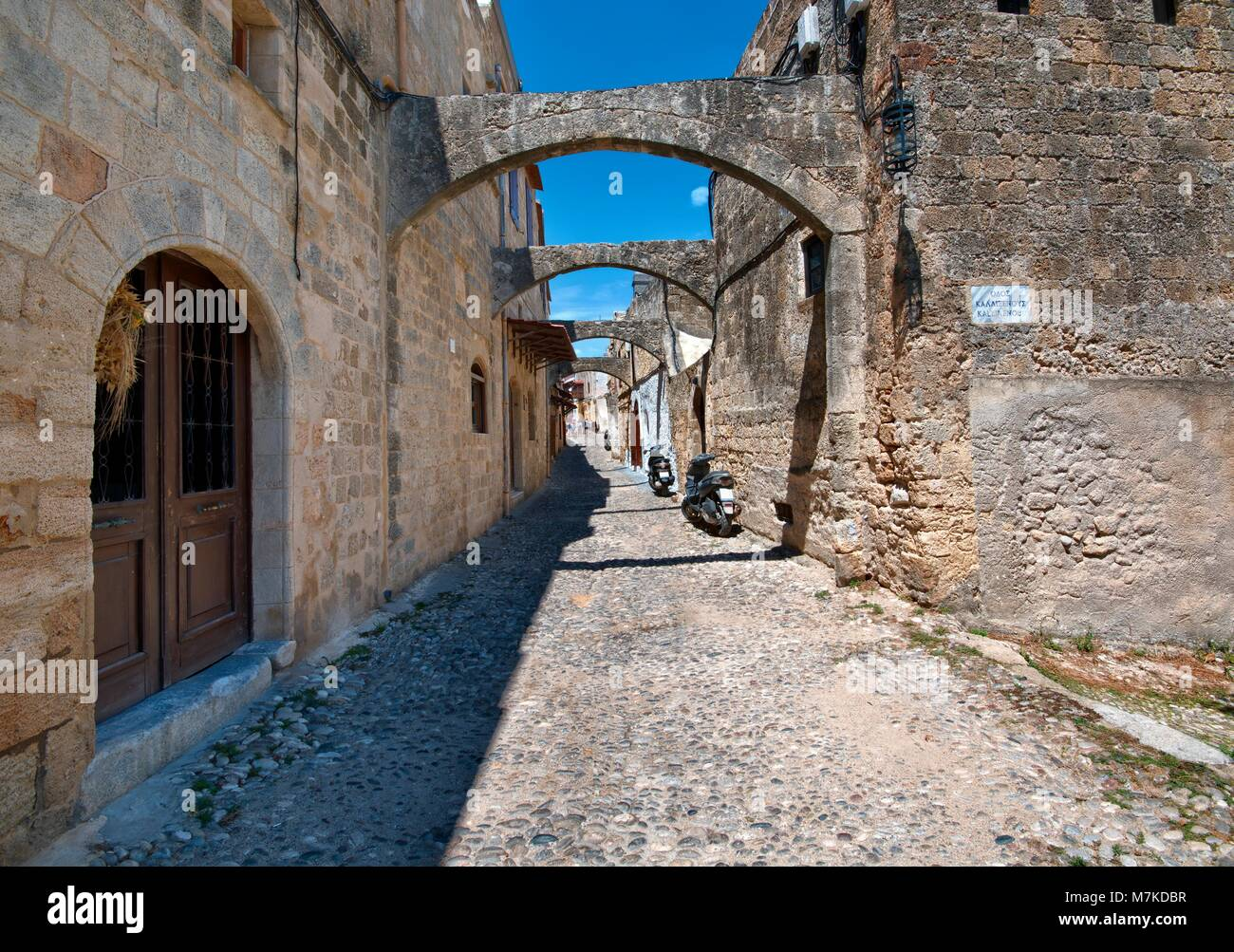 Narrow street and architecture of medieval Old Town of Rhodes - Ippodamou street, Greece - Stock Image