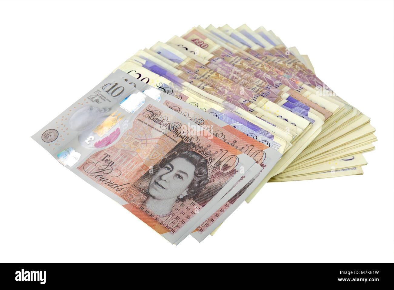 pile of British bank notes on white background - Stock Image
