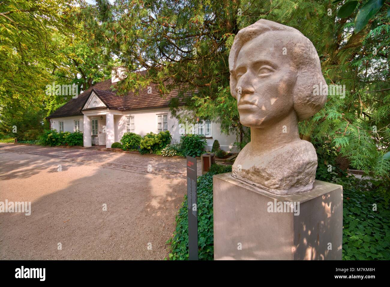 WARSAW, POLAND - AUGUST 20: Statue of Frederick Chopin in the park against his birthplace - little manor-house on - Stock Image