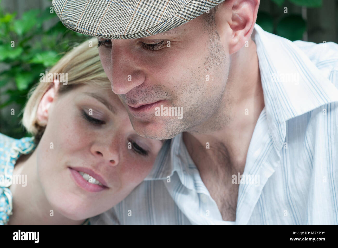 A close up of a couple looking away from the camera. - Stock Image