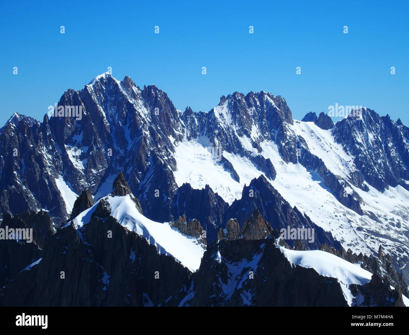 Alpine mountains range landscape in French ALPS seen from Aiguille du Midi at CHAMONIX MONT BLANC in FRANCE Stock Photo