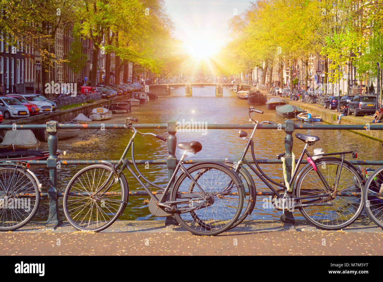 Amterdam canal, bridge and medieval houses - Stock Image