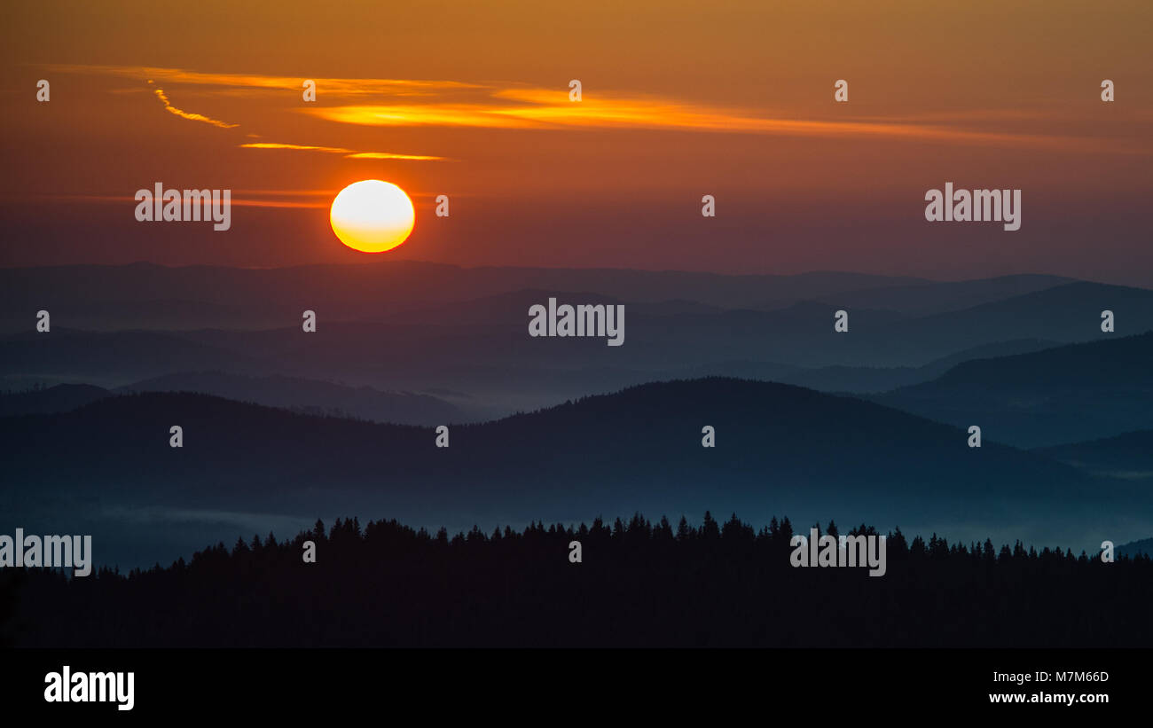 The Sun Rises Again. Sunrise over the mountain range in the early morning with beautiful color contrast from golden - Stock Image