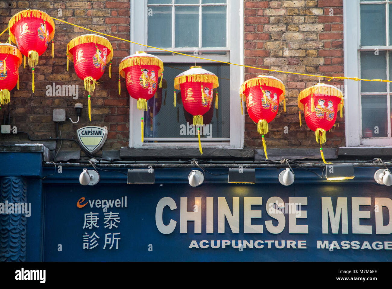 Snow covered Chinese Lanterns in London's Chinatown following a heavy fall of snow - Stock Image