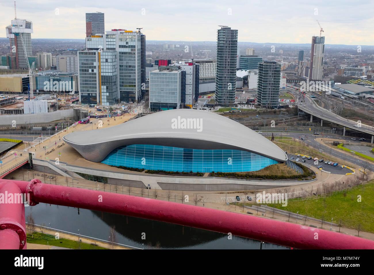 London Aquatics Centre and London Skyline, Stratford, London, UK - Stock Image