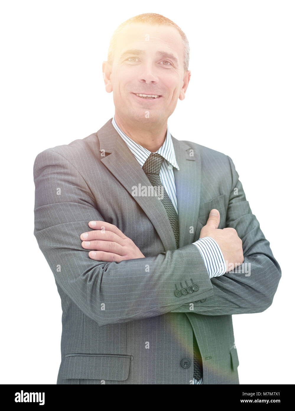 Happy mature man in suit smiling while standing against white - Stock Image