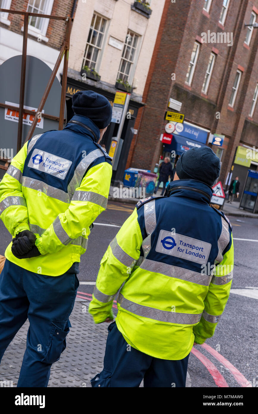transport for london officials or workers marshalling and controlling traffice during a road closure in central - Stock Image