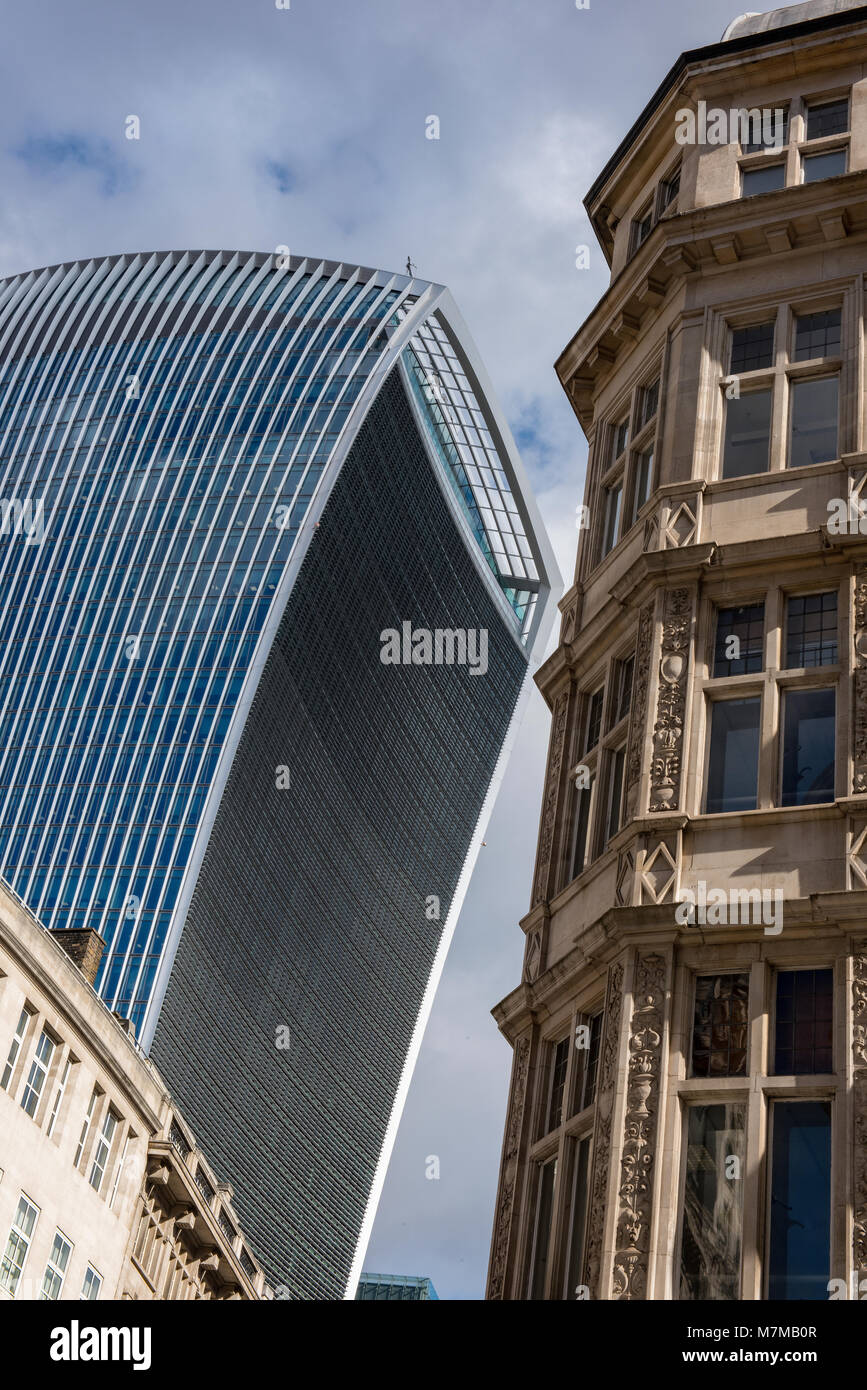 the walkie talkie office building in the square mile or the city of london next toan historic older traditional - Stock Image