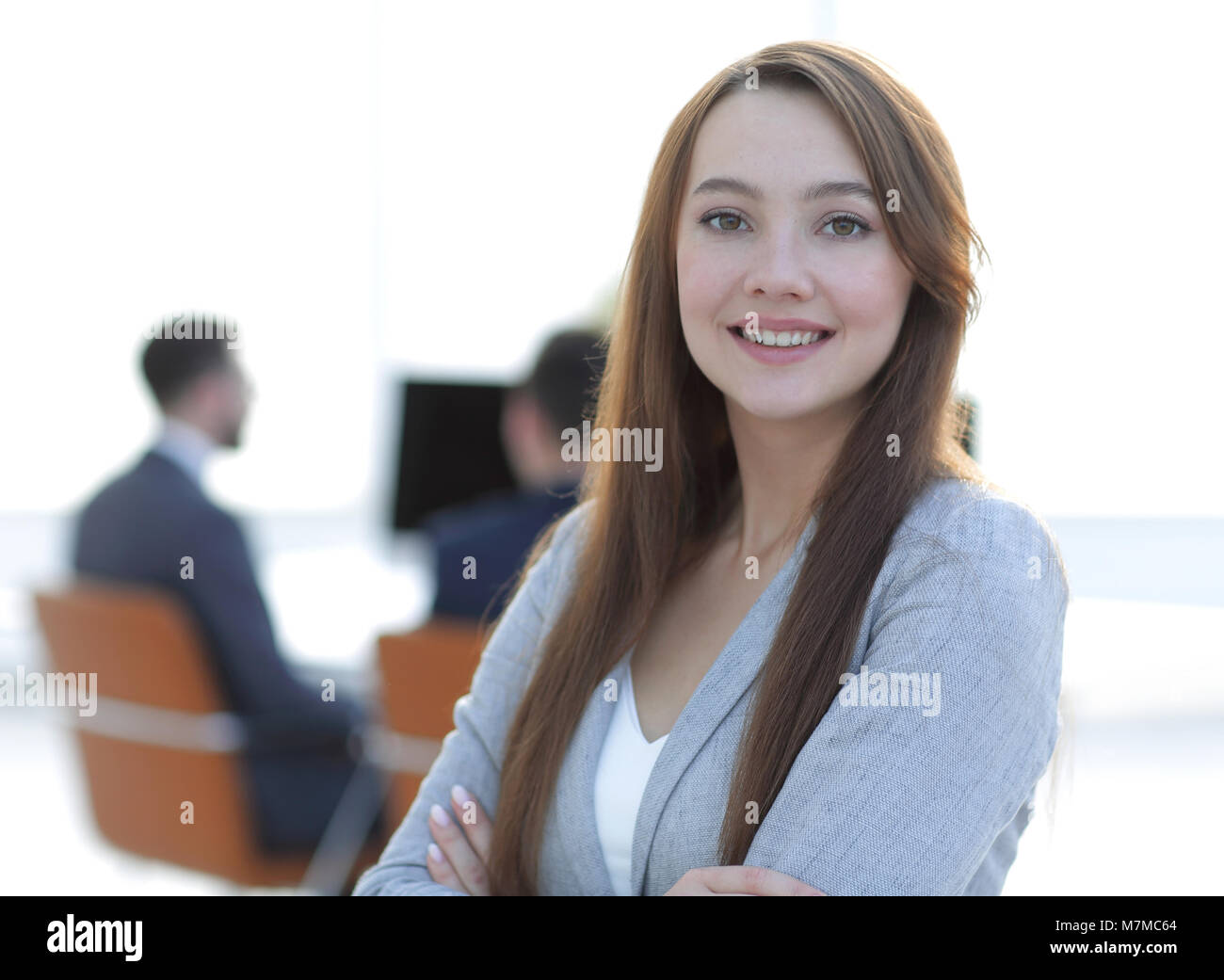 business woman on blurred background office - Stock Image